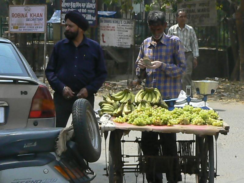 Vendeur de bananes et raisins